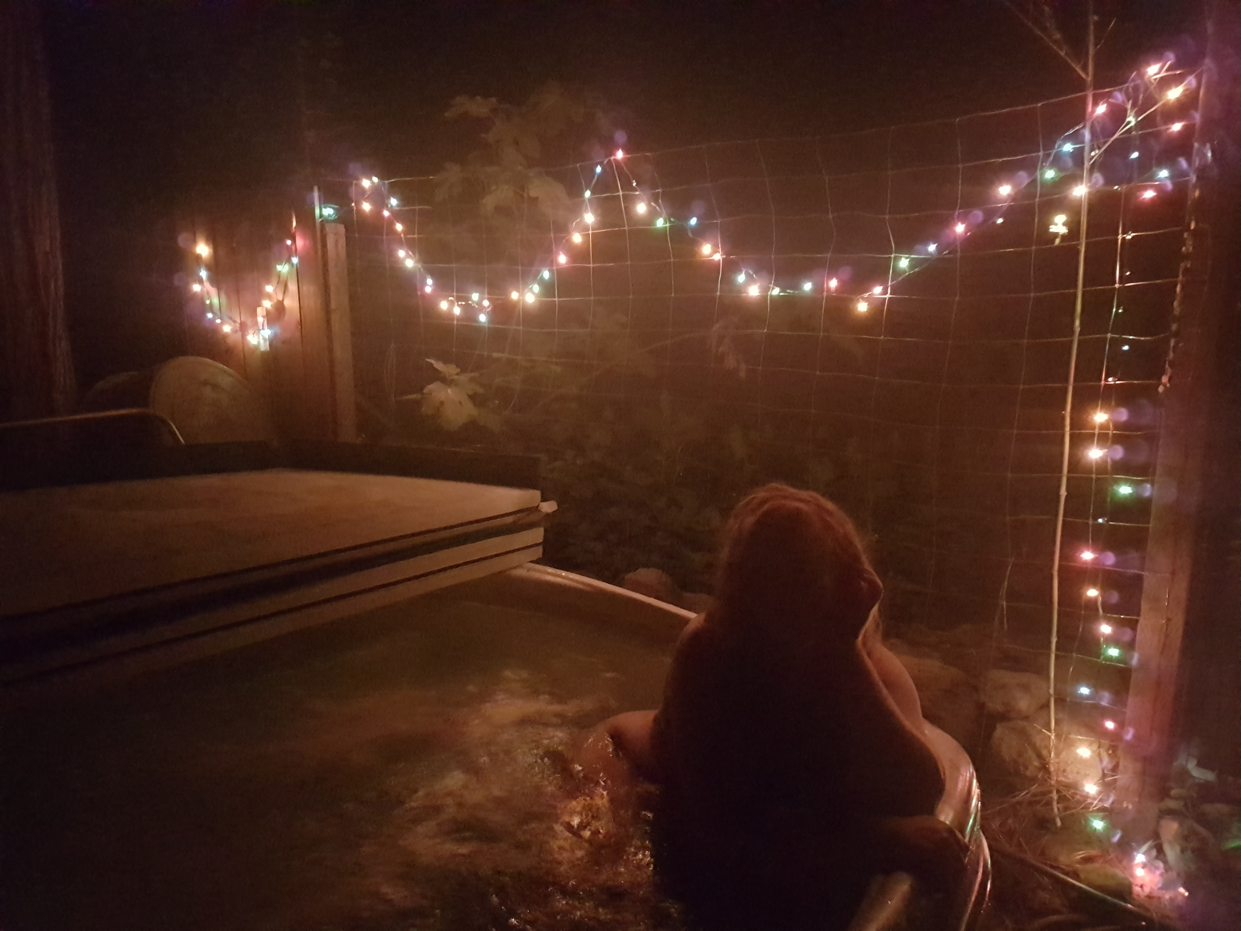 cute babe in hot tube with fairy lights